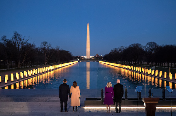 **FILE** President-elect Joe Biden and Vice President-elect Kamala Harris and their spouses participate in a COVID-19 memorial event at the Lincoln Memorial Reflecting Pool in Washington on Jan. 19. (Courtesy of Joe Biden via Twitter)