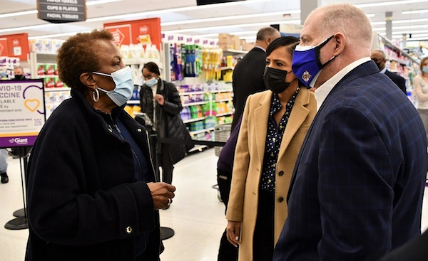 Karen Strayhorn (left) chats with Prince George's County Executive Angela Alsobrooks (center) and Maryland Gov. Larry Hogan while waiting to get a coronavirus vaccination at a Giant pharmacy in District Heights on Jan. 27. (Anthony Tilghman/The Washington Informer)