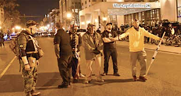 **FILE** The Proud Boys wreaked havoc in Washington, D.C., last month during a protest over the presidential election outcome and returned to the city for demonstrations on Jan. 5 and 6. District of Columbia residents were asked to avoid going downtown. (Anthony Tilghman/The Washington Informer)