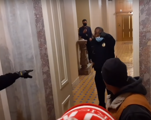 U.S. Capitol Police Officer Eugene Goodman keeps pro-Trump protesters that raided the building from reaching members of Congress on Jan. 6.