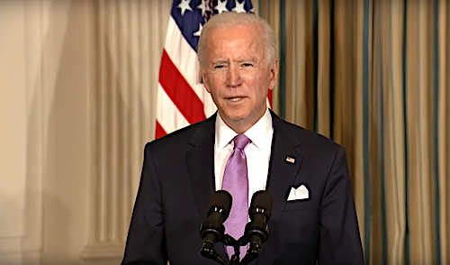 President Joe Biden speaks during a news conference in the State Dining Room of the White House on Jan. 26, 2021.