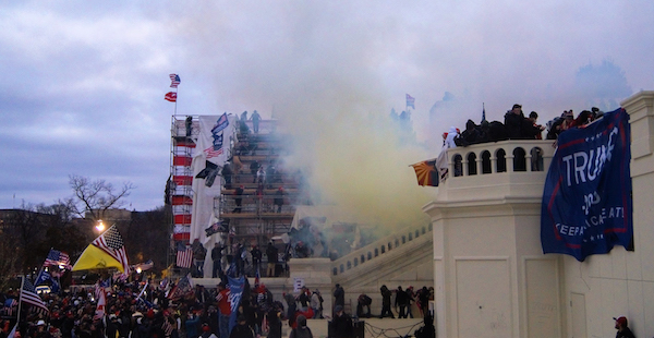 A cloud of tear gas waft through a large crowd of Trump supporters storming the steps of the U.S. Capitol on Jan. 6 as Congress prepares to affirm President-elect Joe Biden's victory. (Tyler Merbler via Wikimedia Commons)