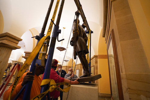 Workers remove a statute of Confederate Gen. Robert E. Lee from U.S. Capitol. (Photo By Jack Mayer, Office of Virginia Gov. Ralph Northam)