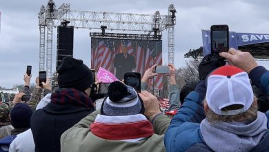 Demonstrators take photos of a video of President Donald Trump as he speaks during a Jan. 6 rally in D.C. protesting his loss in the November presidential election. (Voice of America via Wikimedia Commons)