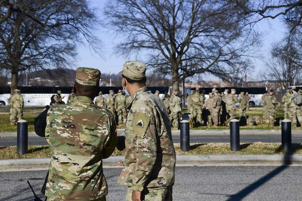 Guard members in-process upon arriving in Washington, D.C., on Jan. 7, 2021. National Guard Soldiers and Airmen from several states have traveled to the National Capital Region to provide mission support to federal and district authorities. (Senior Airman Amanda Bodony)