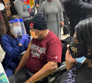 Robert Gaskin receives a dose of coronavirus vaccine at a vaccination clinic at Reid Temple AME Church in Glenn Dale, Maryland, on Feb. 12. (William J. Ford/The Washington Informer)