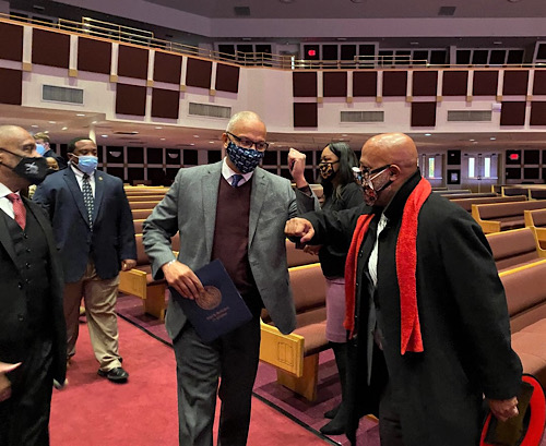 Maryland Lt. Gov. Boyd Rutherford (center) greets Prince George's County Council Chair Calvin Hawkins II inside Reid Temple AME Church in Glenn Dale, where a coronavirus vaccination clinic has been set up, on Feb. 12. (William J. Ford/The Washington Informer)