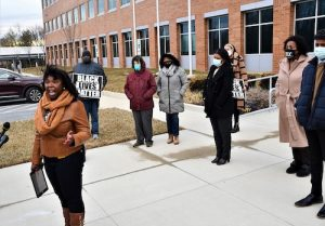Krystal Oriadha, a local activist with PG Change Makers, leads a press conference outside the Wayne K. Curry Administration Building in Largo, Maryland, on Feb. 16. (Anthony Tilghman/The Washington Informer)