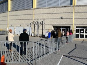 Prince George's County Public Schools employees line up outside Wayne K. Curry Sports and Learning Center in Landover, Maryland, to receive a coronavirus vaccine on Jan. 30. (William J. Ford/The Washington Informer)