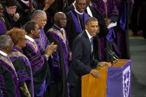 **FILE** President Barack Obama gives the eulogy on June 26, 2015, at the funeral of Clementa Carlos Pinckney, senior pastor at Mother Emanuel African Methodist Episcopal Church in Charleston, S.C. (Courtesy of PBS)