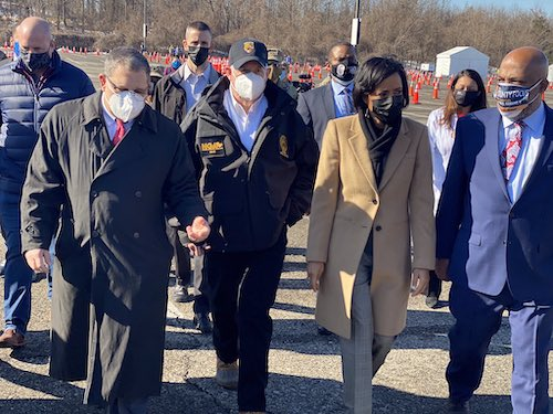 Maryland Gov. Larry Hogan (fourth from left) and Prince George's County Executive (third from right) visit a coronavirus vaccination site at Six Flags America in Bowie on Feb. 5. (Courtesy of Alsobrooks via Twitter)