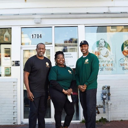 From left: Jermaine Smith, Henrietta Smith and Bernard Brooks Jr. stand in front of Henry's Soul Café, one of the six Black-owned businesses highlighted by the Washington Wizards Black-Owned DMV initiative. (Courtesy of the Washington Wizards)