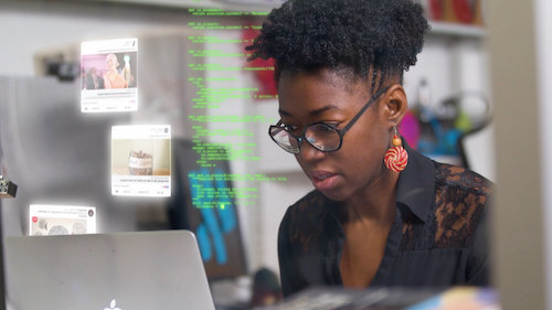"""Facial recognition research from Joy Buolamwini, a Ph.D. candidate at the MIT Media Lab, is the subject of the documentary """"Coded Bias"""" produced and directed by Shalini Kantayya. (Courtesy of Independent Lens)"""
