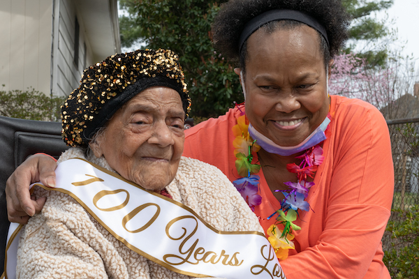 Virginia Ada Hawkins Keane, who celebrated her 101st birthday Saturday, March 24, poses for a photo with her daughter Karen. Neighbors, friends and family gathered for a drive-by celebration at her home in Northwest. (Shevry Lassiter/The Washington Informer)