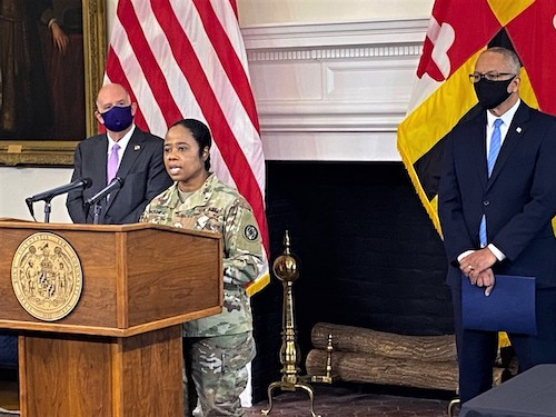 Brig. Gen. Janeen Birckhead of the Maryland National Guard speaks at a March 4 press briefing in Annapolis as Gov. Larry Hogan (right) and Lt. Gov. Boyd Rutherford listen. (William J. Ford/The Washington Informer)
