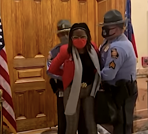 Georgia state troopers arrest Democratic state Rep. Park Cannon in the state capitol on March 25 as Republican Gov. Brian Kemp signed a law enacting broad voting restrictions that activists say target Black voters.
