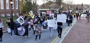 Demonstrators with the Maryland Coalition for Justice and Police Accountability call for police reform during a march toward the State House in Annapolis on March 4. (Rob Roberts/The Washington Informer)