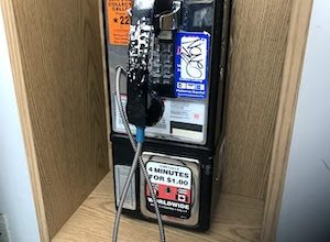 Once upon a time, pay phones were a staple on almost every street corner. After searching high and low, a pay phone was located during a drive on I-95. (DR Barnes/ The Washington Informer)