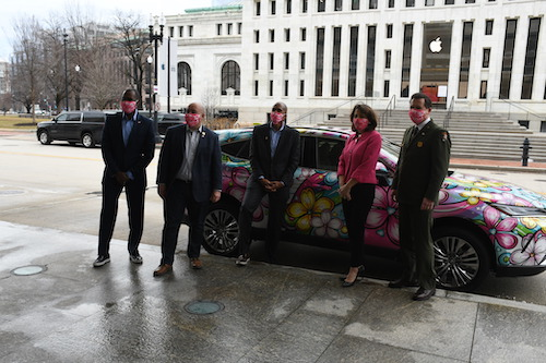 From left: Matt Long, Car Art; John Falcicchio, Deputy Mayor for the District of Columbia; Greg O'Dell, President, Events DC; Diana Mayhew, President, 2021 National Cherry Blossom Festival; and, Jeff Reinbold, Superintendent, National Park Service, in front of the Cherry Blossom Festival Car in northwest D.C. on March 1. (Roy Lewis/The Washington Informer)