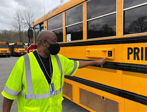 Johnnie Walker, a Prince George's County Public Schools bus-driver trainer, shows two cameras installed on one of nearly 1,300 buses at a lot in Upper Marlboro on March 31. (William J. Ford/The Washington Informer)