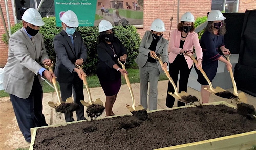 Former Prince George's County official Major Riddick (left) joins County Executive Angela Alsobrooks (center) and Luminis Health officials to toss dirt at a groundbreaking ceremony for a behavioral health center next to Doctors Community Medical Center in Lanham, Maryland, on April 19. (William J. Ford/The Washington Informer)