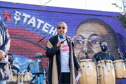Del. Eleanor Holmes Norton (D) speaks to the people gathered at the Secret Garden in Southeast during an Emancipation Day gathering. (Ja'Mon Jackson/The Washington Informer)