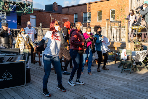 People dance to the music at the DC Freedom Concert that took place at the Secret Garden in Anacostia on the District's Emancipation Day holiday on April 16. (Ja'Mon Jackson/The Washington Informer)