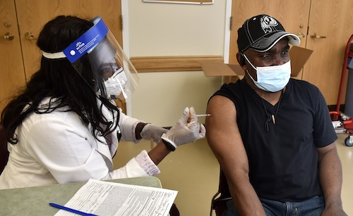 James Page receives a dose of the Pfizer coronavirus vaccine at the Bowie Senior Center in Bowie, Maryland, on April 21. (Robert R. Roberts/The Washington Informer)
