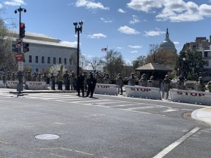 Authorities line barriers outside the U.S. Capitol on April 2 after a motorist rammed his vehicle into two Capitol Police officers at one of the barricades. The suspect was fatally shot by authorities after emerging from the vehicle and charging at the two officers, one of whom also later died. (Hamil R. Harris/The Washington Informer)