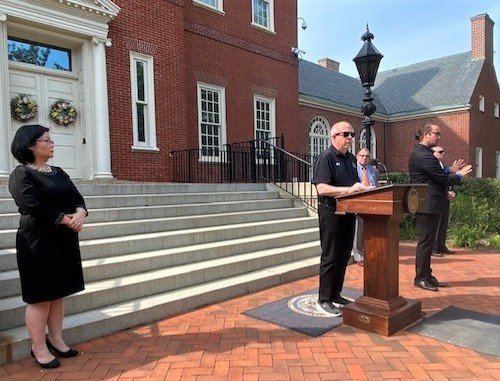 Maryland Gov. Larry Hogan (center) speaks outside the governor's mansion in Annapolis during an April 28 press conference to announce he is lifting a mandate for wearing masks outdoors amid the coronavirus pandemic. (William J. Ford/The Washington Informer)