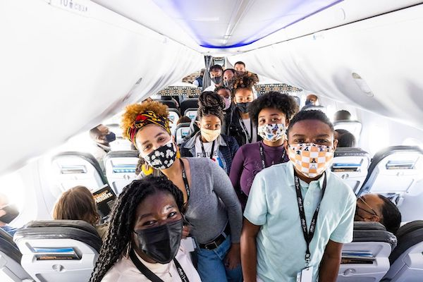 Students whose silhouettes are featured on the plane are telling everyone about the visual display of Alaska Airlines' commitment to fight injustice. (Brigette Squire/The Washington Informer)