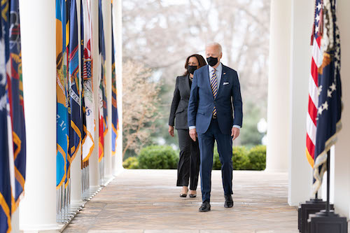 **FILE** President Joe Biden and Vice President Kamala Harris walk from the Oval Office of the White House Friday, March 12, 2021, to the Rose Garden to deliver remarks on the American Rescue Plan. (Official White House Photo by Lawrence Jackson)