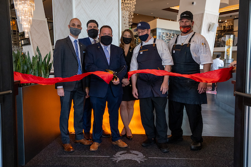 The ribbon is cut to officially open Truluck's, the new seafood restaurant in the Mt. Vernon Square area. (Ja'Mon Jackson/The Washington Informer)