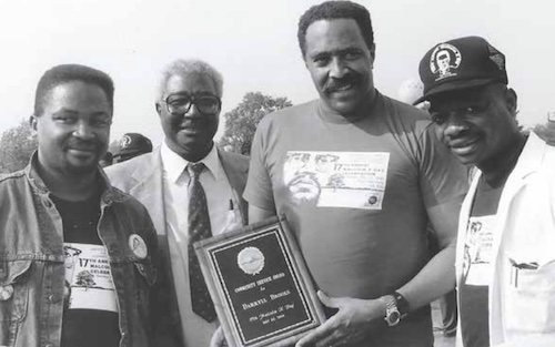 From left: Honoring the life and legacy of Malcolm X, these four men, Malik Edwards, Dr. Calvin W. Rolark Sr., Darryll Brooks and Charles Stephenson, led the way in the formative years of the District's Malcolm X Day Celebration held annually on May 19. (Courtesy of Darryll Brooks)