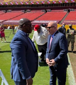 Maryland Gov. Larry Hogan (right) chats May 13 with the Rev. Cary James Jr. at FedEx Field in Landover. The governor praised faith and community leaders for their efforts in helping to combat the coronavirus. (William J. Ford/The Washington Informer)
