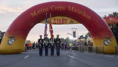 """**FILE** The Marine Corps Color Guard presents the National and Marine Corps colors during the singing of the National Anthem prior to the commencement of the 41st annual Marine Corps Marathon, which travels on a monumental course through Washington, D.C. and finishes at the Marine Corps War Memorial, Arlington, Va., Oct. 30, 2016. Also known as """"The People's Marathon,"""" the 26.2 mile race drew roughly 30,000 participants to promote physical fitness, generate goodwill in the community, and showcase the organizational skills of the Marine Corps. (U.S. Marine Corps photo by Staff Sgt. Sarah R. Hickory)"""