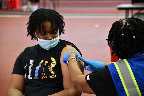 Jasmine Jennings, 17, not only received a Pfizer vaccine May 14 but was also rewarded with two free tickets to Six Flags America and a McDonald's gift card as the first teenager to arrive at 6 p.m. during vaccine-a-thon. (Anthony Tilghman/The Washington Informer)