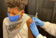 Jacque Patterson Jr. received his Pfizer/BioNTech coronavirus vaccination at the R.I.S.E. Demonstration Center on May 14. (Courtesy of Jacque Patterson Sr.)