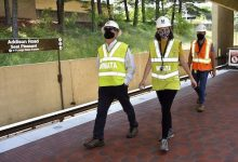 Metro General Manager Paul Wiedefeld (left) leads a tour of the platform work conducted at the Addison Road-Seat Pleasant Metrorail station on May 20. The station is set to reopen May 23 after months of renovation. (Robert R. Roberts/The Washington Informer)