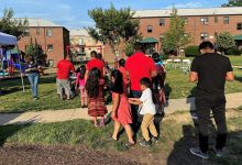 **FILE** Prince George's County residents line up during a COVID-19 vaccination clinic outside Langley Terrace Apartments in Hyattsville, Maryland, on June 18. (William J. Ford/The Washington Informer)