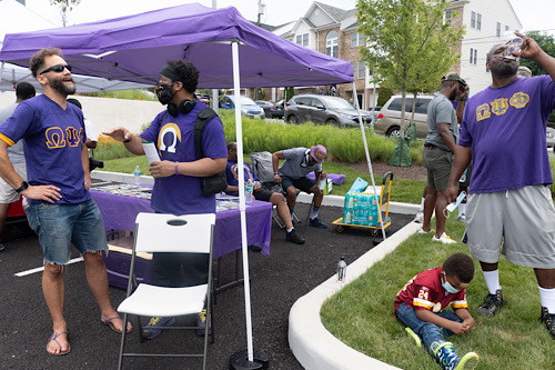 People mix and mingle at the Fathers to the Front event at Martha's Table on June 19, Juneteenth. (Shevry Lassiter/The Washington Informer)