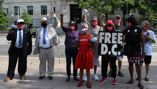 **FILE** D.C. statehood activists hold court in front of the John A. Wilson Building in Northwest. (Roy Lewis/The Washington Informer)