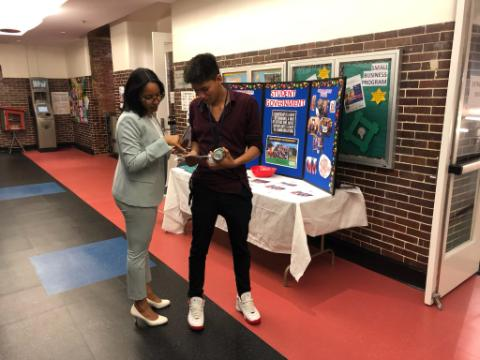 Olianka Wingate, student services director at Carlos Rosario International Public Charter School, talks with a student. (Courtesy photo)