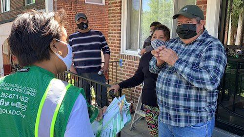 **FILE** D.C. Mayor Muriel Bowser (left) goes door to door in an attempt to convince residents to get a coronavirus vaccination. (Courtesy of Bowser via Twitter)