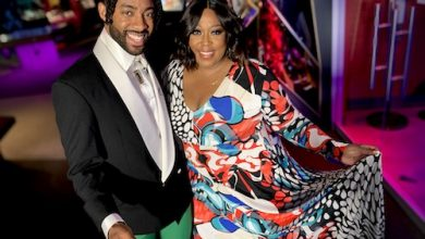 """Hosting the Salute THEM Awards are Loni Love (right), co-host of Café Mocha, and Saint Aubyn, singer and actor who portrayed Dennis Edwards in the Broadway musical """"Ain't Too Proud."""" The awards program will air on June 6 at 10 p.m. ET from the new National Museum of African American Music in Nashville, Tenn., on BCN and via www.SaluteTHEMAwards.com. (Courtesy of Miles Ahead Entertainment)"""