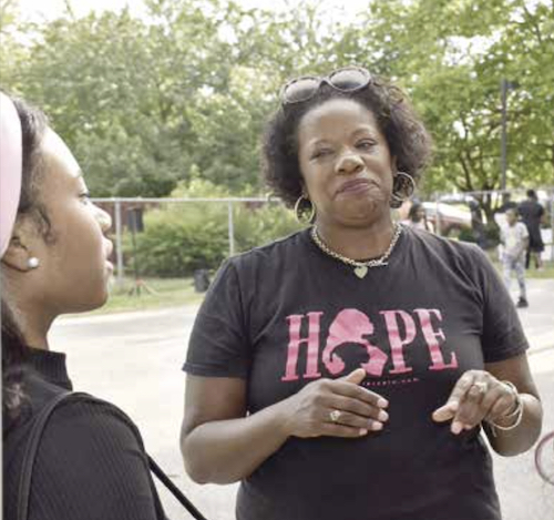 """Prince George's County State's Attorney Aisha Braveboy chats with a teenager at an """"Our Streets, Our Future"""" event in District Heights on June 25. (Robert R. Roberts/The Washington Informer)"""
