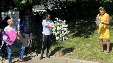 Howard Brent (center) and Cassy Morris (right), members of the LGBTQ Dignity Project, participate in a June 25 ceremony in Fairmount Heights to memorialize Zoe Spears and Ashanti Cameron, two Black transgender women killed in the city two years ago. (William J. Ford/The Washington Informer)