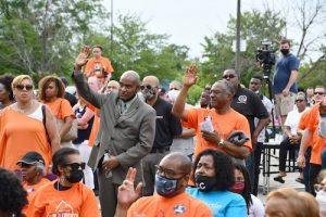 Prince George's County elected officials, community leaders and residents wear orange T-shirts to commemorate Gun Violence Awareness Month during a community rally outside Jericho City of Praise Family Ministries in Landover, Maryland, on June 1. (Anthony Tilghman/The Washington Informer)