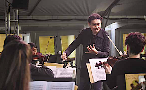 Alejandro Hernandez-Valdez, the artistic director of the New Orchestra of Washington and the conductor for the evening, leads the orchestra in a performance of compositions written by African-American composers on Juneteenth at the Strathmore. (Courtesy of Strathmore)