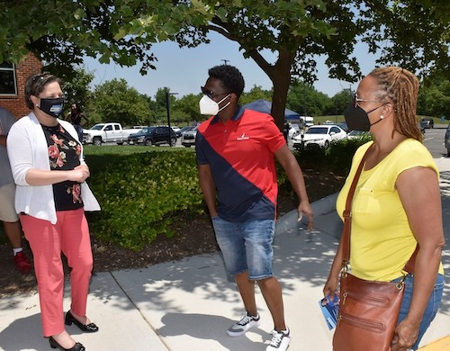Virginia state Sen. and gubernatorial candidate Jennifer McClellan (left) chats with voters at a polling site in Woodbridge on June 5, the last day of early voting in the state. (Robert R. Roberts/The Washington Informer)